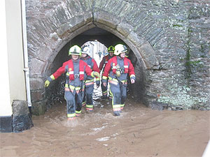 fire brigade dealing with floods in lostwithiel